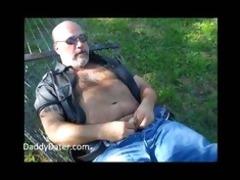 bushy dad bear wanking on a sunny day